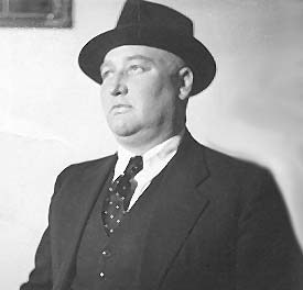 Joseph F. Schulte around 1935 in hat and vested suit